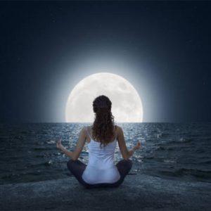 Spiritual Workshops - Woman meditating at full moon